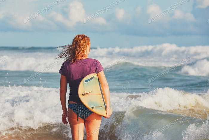 Surfer girl enjoying vacations