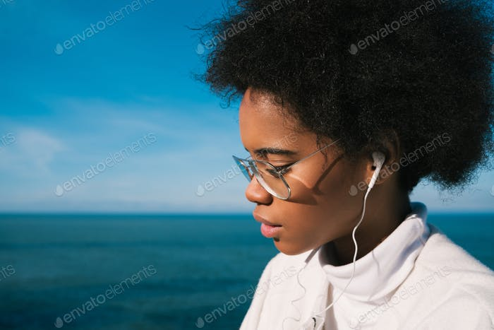 Woman listening to music with earphones.