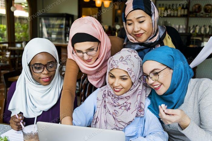 Islamic women friends working together