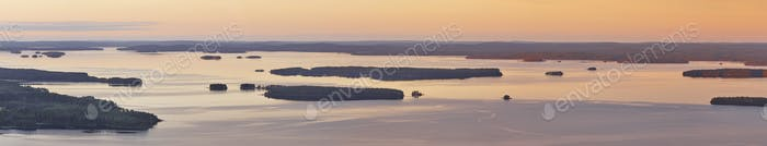 Panoramic finnish landscape at sunset. Lake Pielinien. Koli viewpoint. Finland