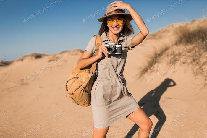 woman in desert walking on safari