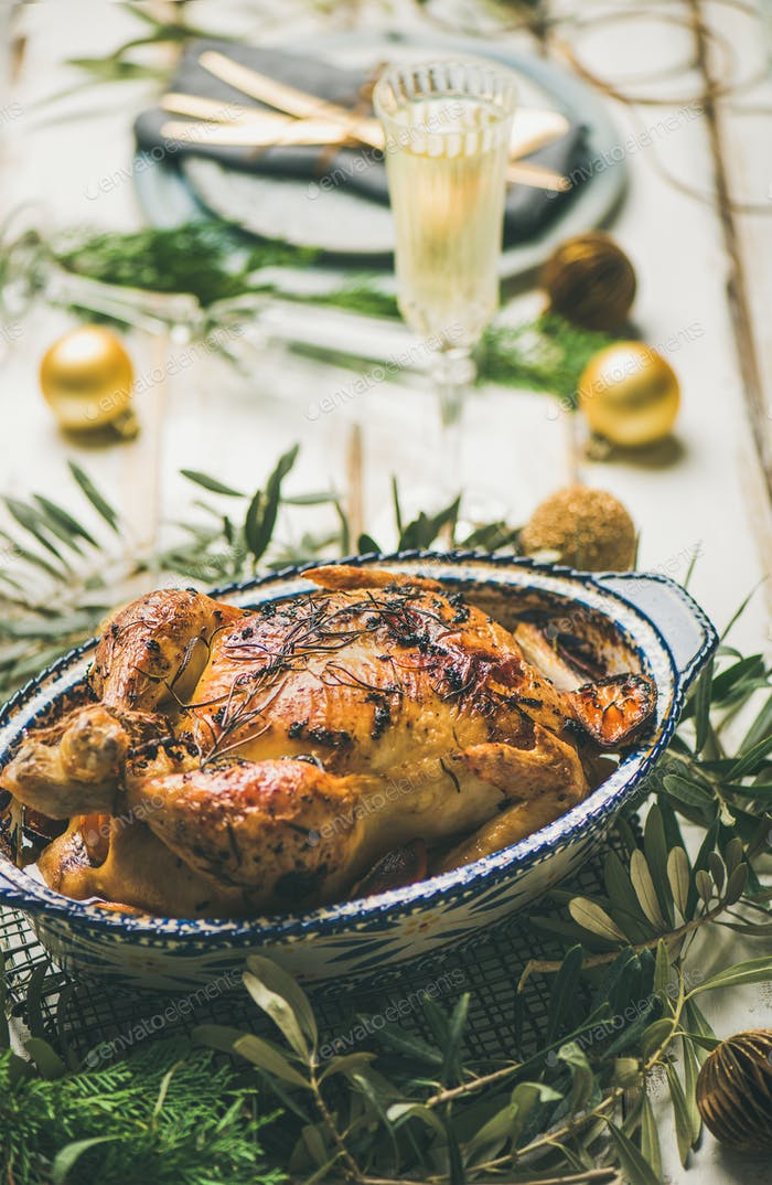 Roast chicken over Christmas or New Year celebration table setting