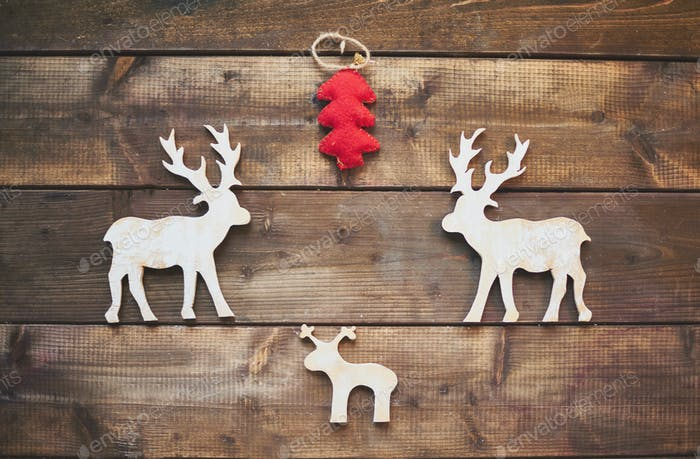 Wooden deer and red firtree