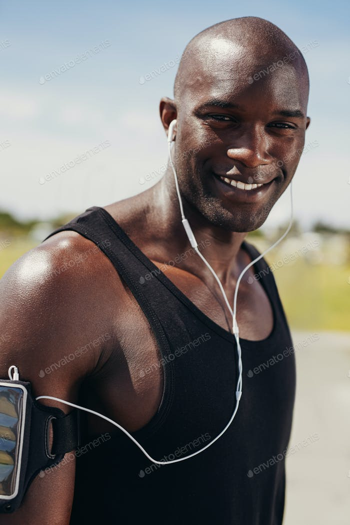 Happy young man wearing earphones
