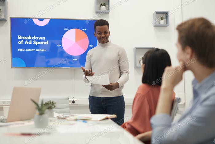 Young African Man Giving Presentation on Marketing