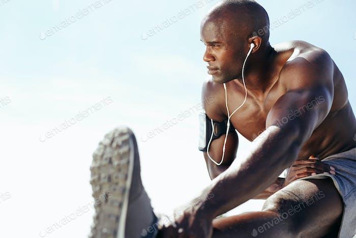 Shirtless man exercising outdoors