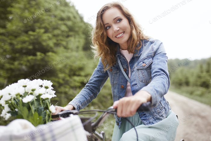 Happy cyclist riding in forest