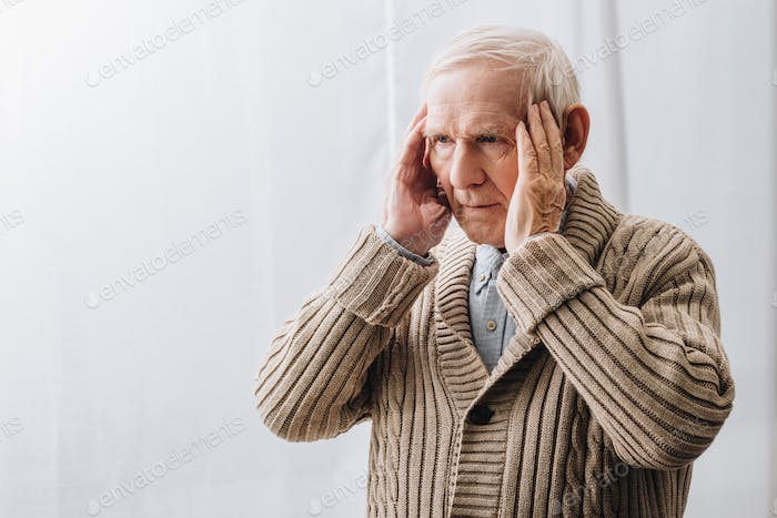 pensioner with dementia disease having headache at home