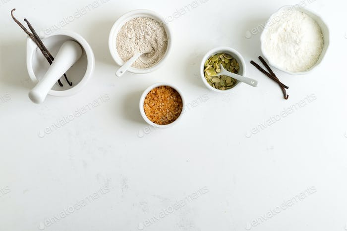 Organic natural ingredients for making homemade freshly baked bread or delicious pastry on a light