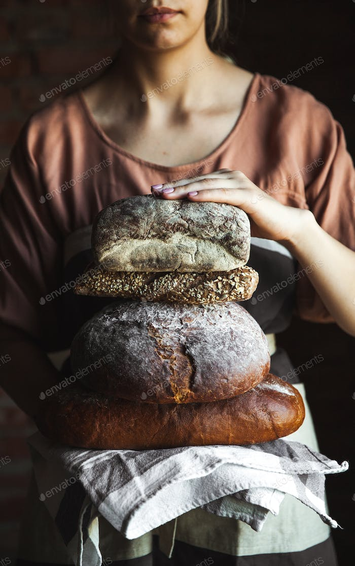 Fresh bread in the hands of a baker. Food, baking