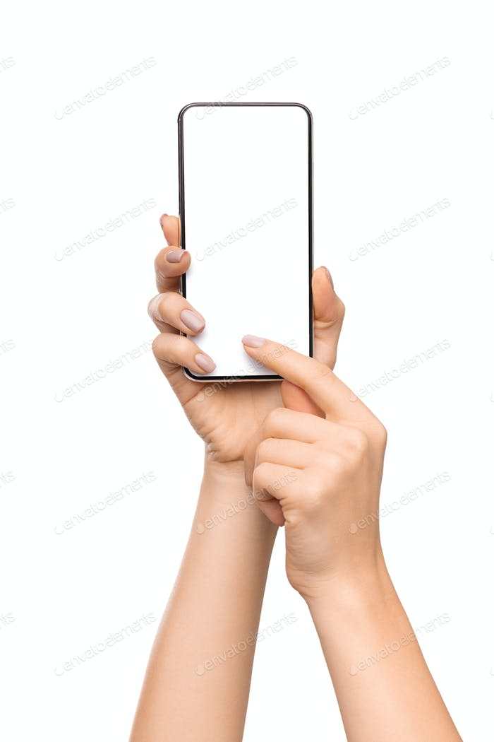 Woman holding smartphone with blank screen and pointing on it