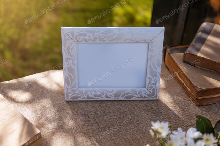 Photo frame surrounded by objects at a wedding