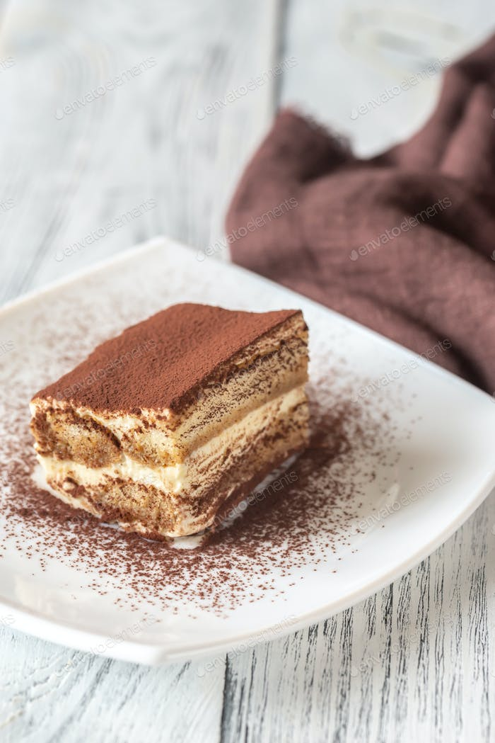 Portion of tiramisu on the white plate