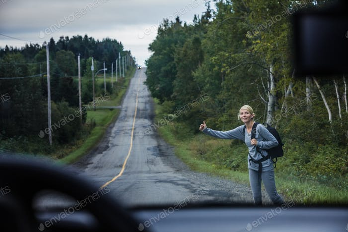 Blonde Woman Hitchhiking