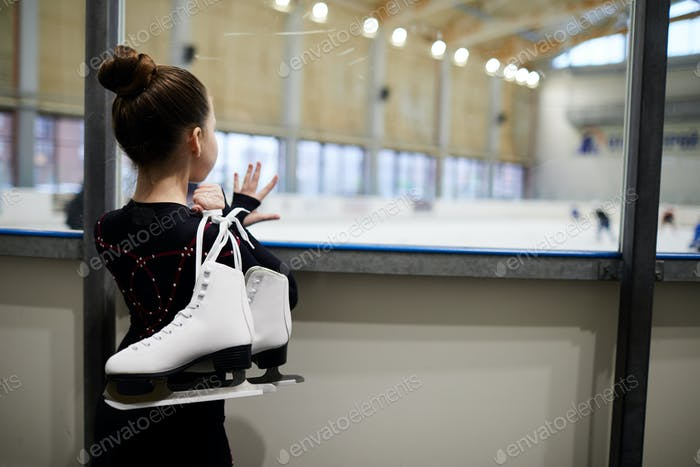 Girl Watching Figure Skaters