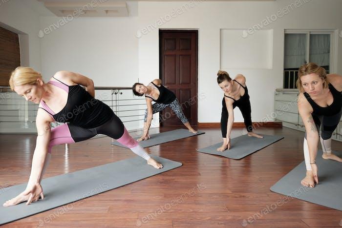 Women Doing Low Lunge Pose