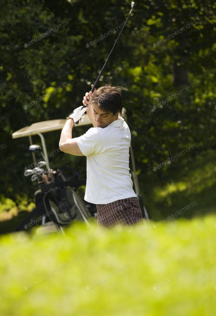 Adult Man Holding Club And Playing Golf