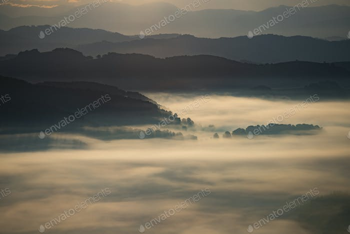 Magic sunrise in a Carpathian mountain valley