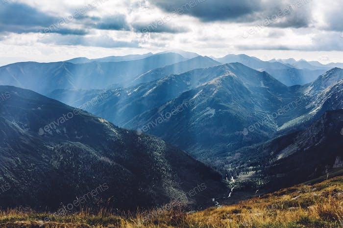 Mountain peaks in sunbeams. Tatra Mountains in Poland.