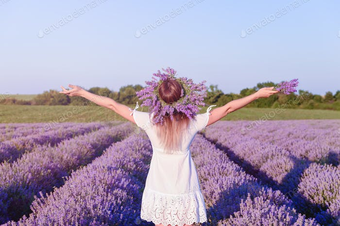 Young, happy, beautiful girl in lavender field