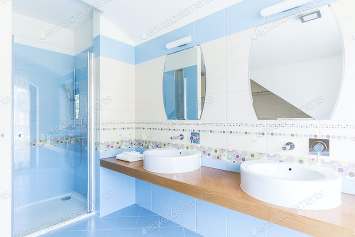 Blue bathroom with double sinks