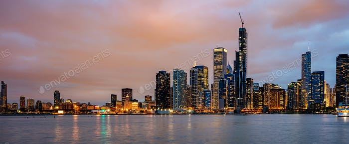 Panoramic view of Chicago city high rise buildings cloudy sky in the evening