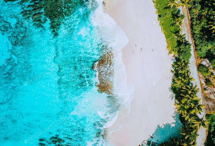 Aerial photo of amazing paradise tropical beach Anse Bazarca at Mahe island, Seychelles. White sand
