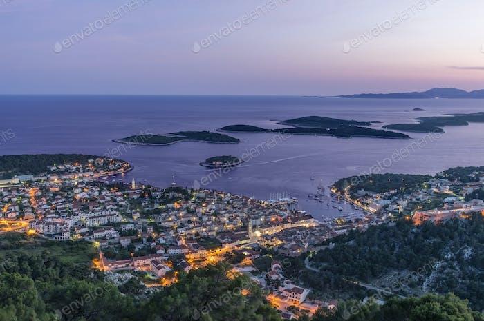 Aerial view of coastal town illuminated at night