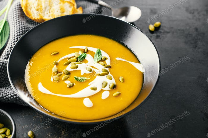 Pumpkin creamy soup served in bowl