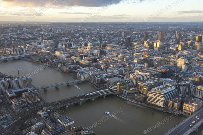 Aerial view of London with bridges crossing river Thames.