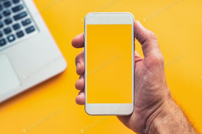 Smartphone in hand with mock up screen