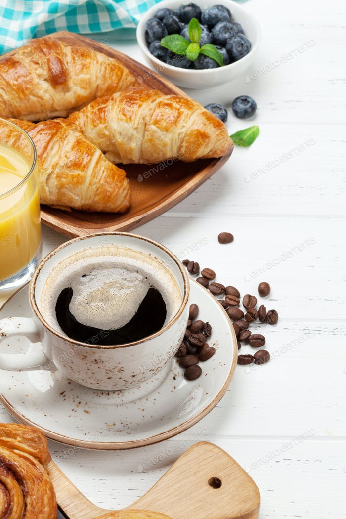 Coffee, juice and croissants breakfast
