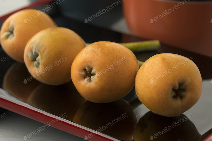 Fresh picked loquats on a Japanese dish
