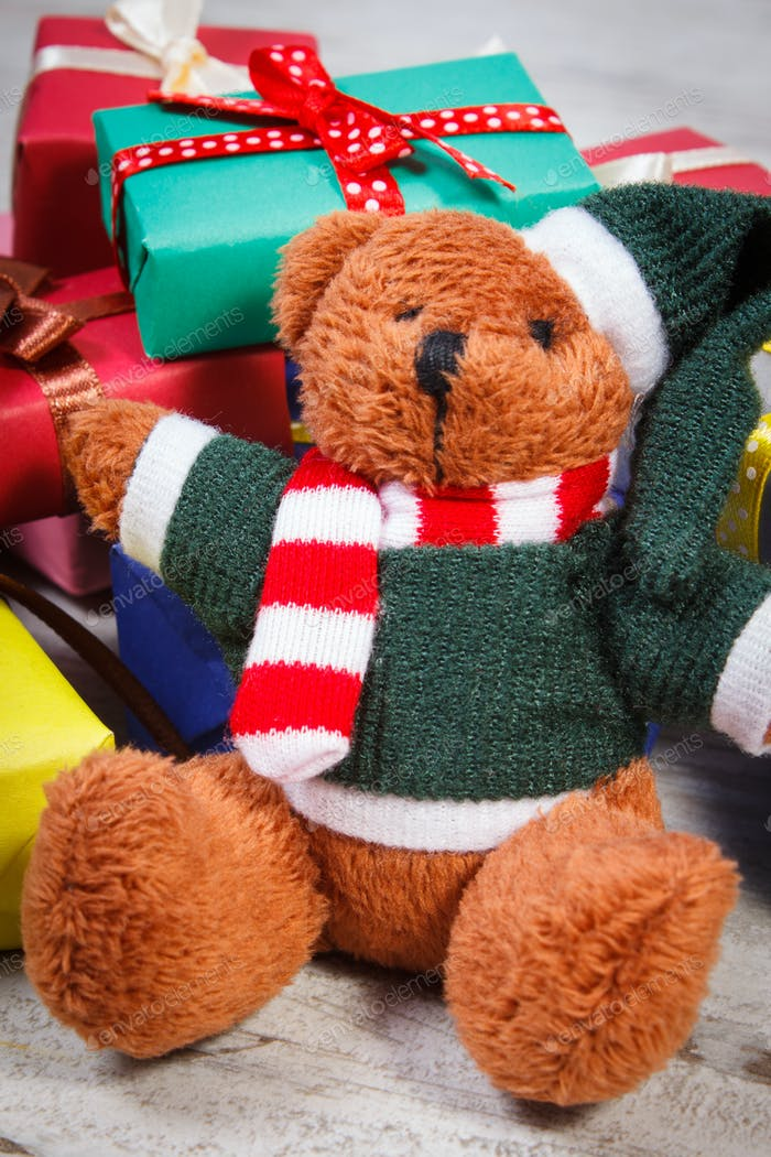 Teddy bear with colorful gifts for Christmas or other celebration