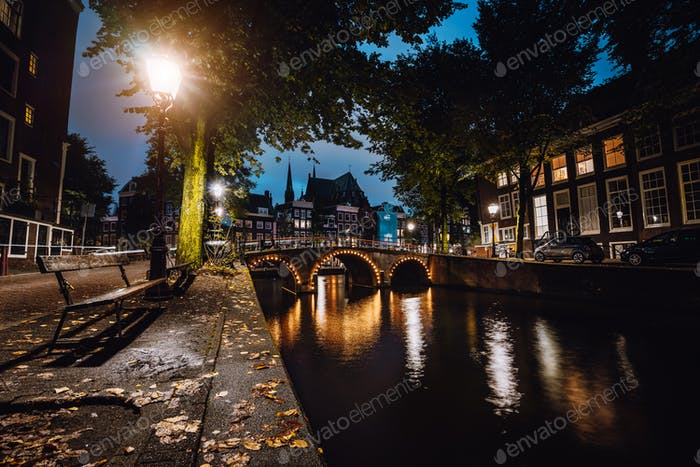 Tranquil scene of Amsterdam, autumn cityscape of beautiful bridge over canal. the Netherlands. Long