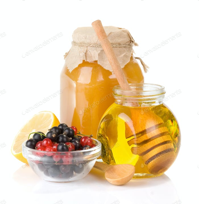 glass jar full of honey and berry