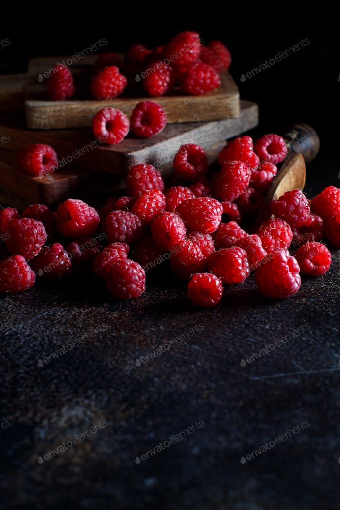 Fresh raspberries on a dark background