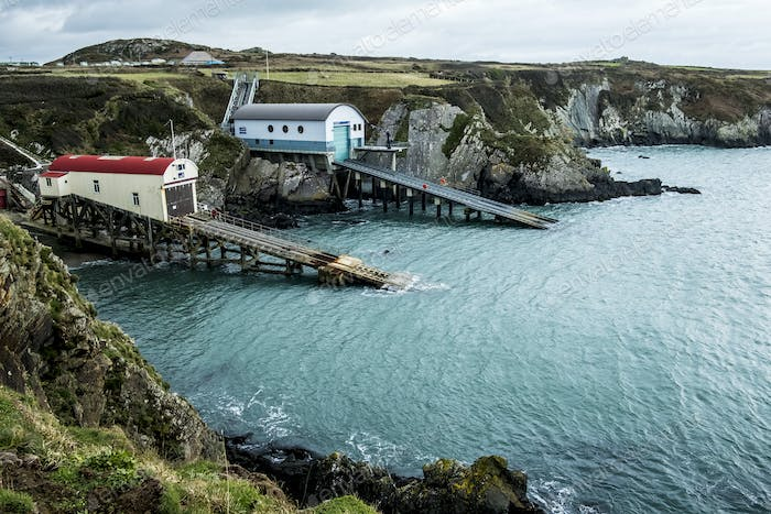 View of the new and old boat houses, St Davids Lifeboat Station in St. Justinian, Pembrokeshire,