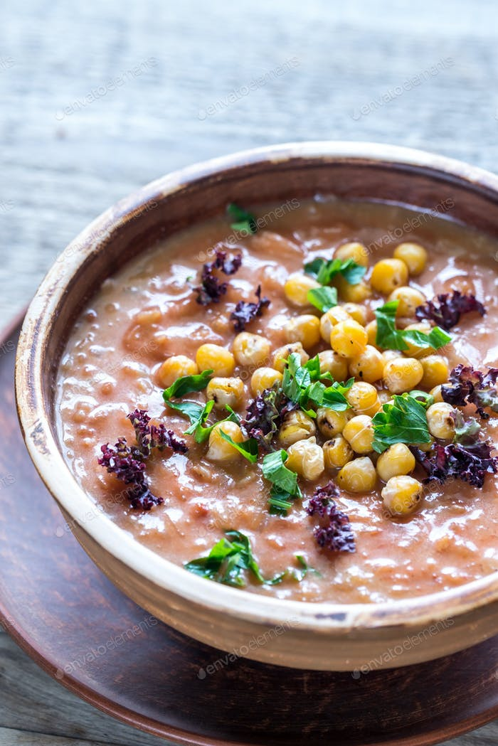 Bowl of chickpea soup on the wooden table
