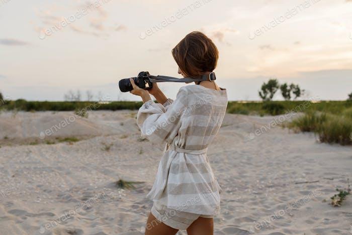 Female photographer taking photos