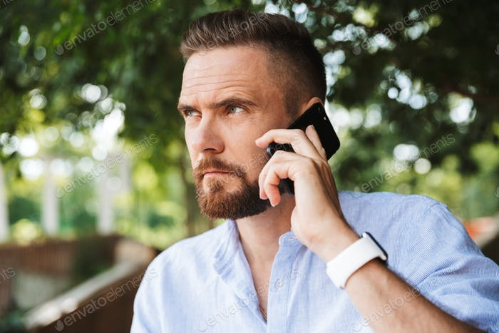 Handsome serious young bearded man