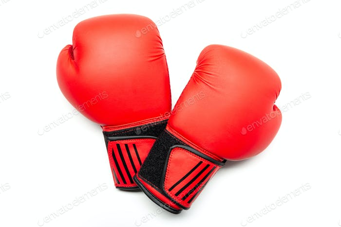 Pair of red boxing gloves isolated on white background