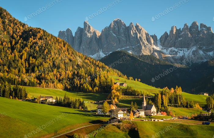 Dolomites village Funes in an autumn landscape