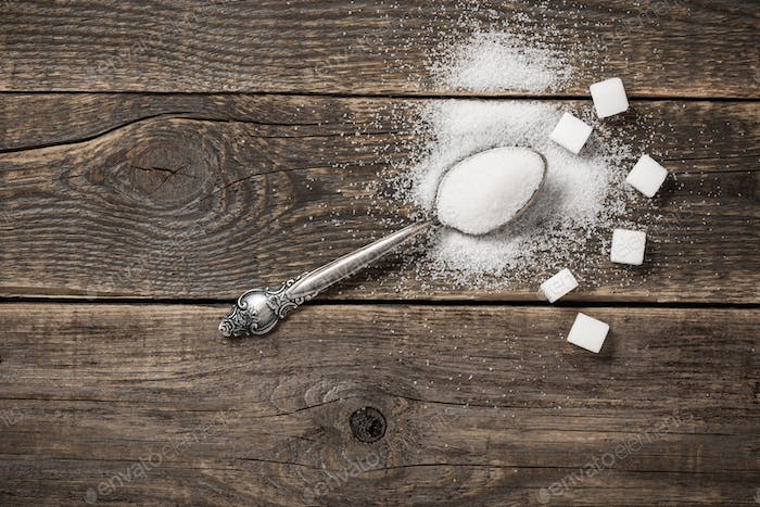 White sugar on wooden boards