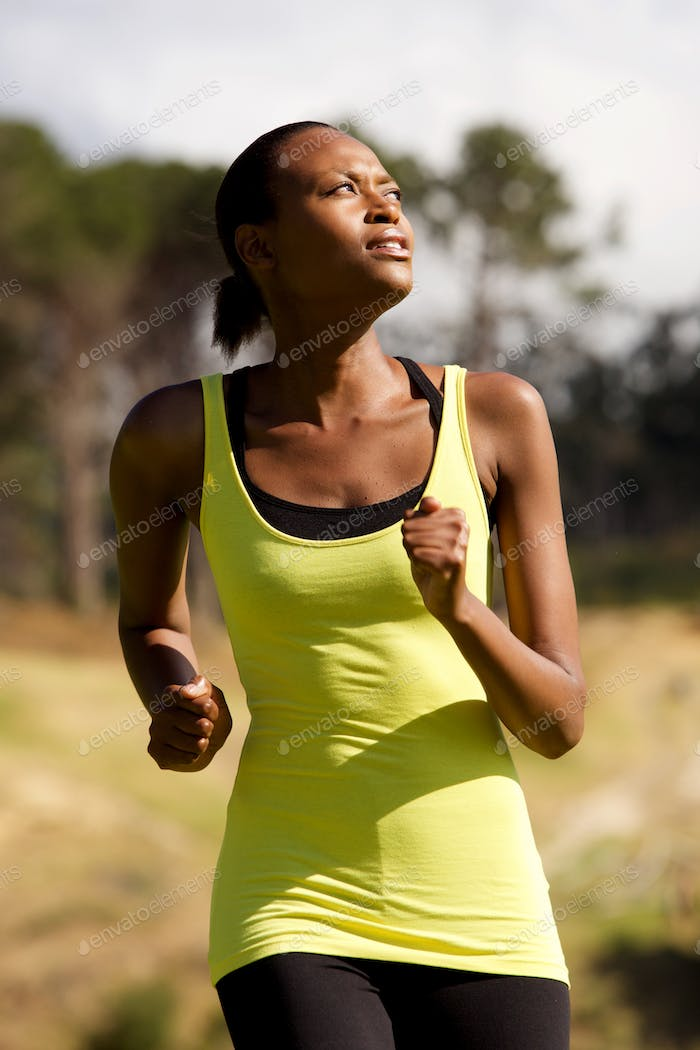 Young sporty woman running outdoors in the park