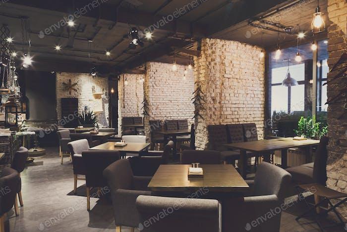 Interior of cozy restaurant, loft style