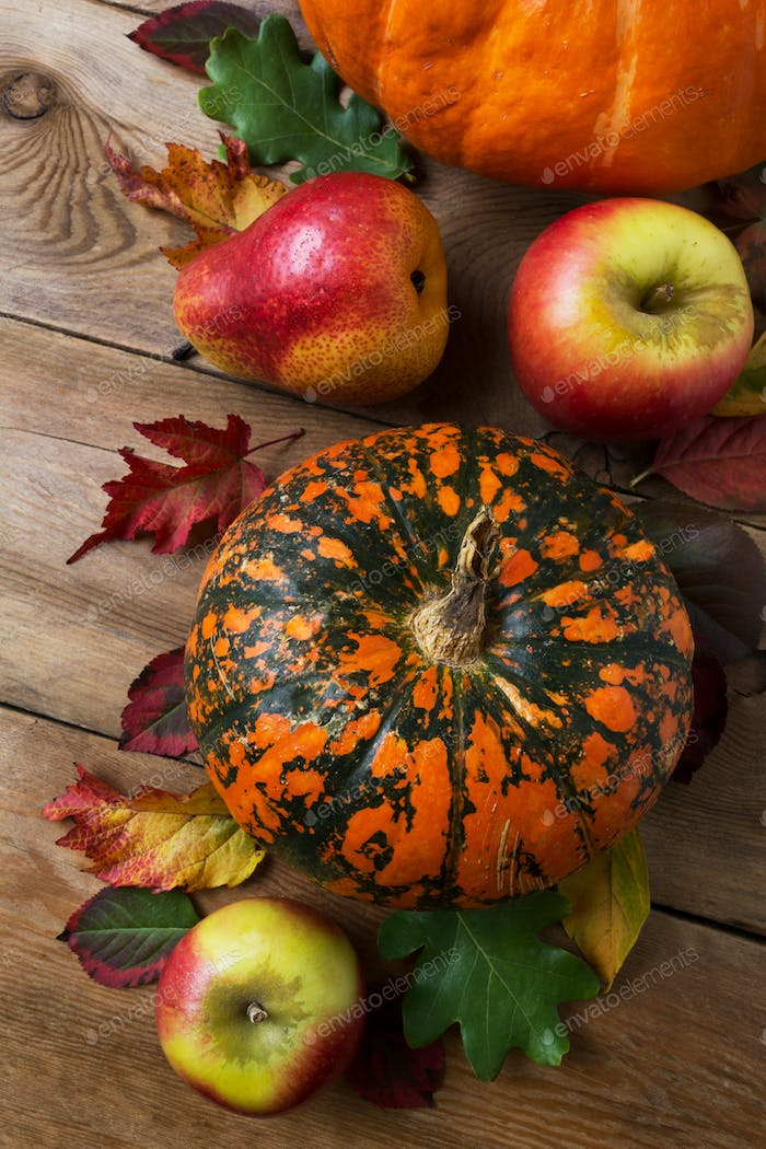 Fall decor with pumpkin, apples and red pear