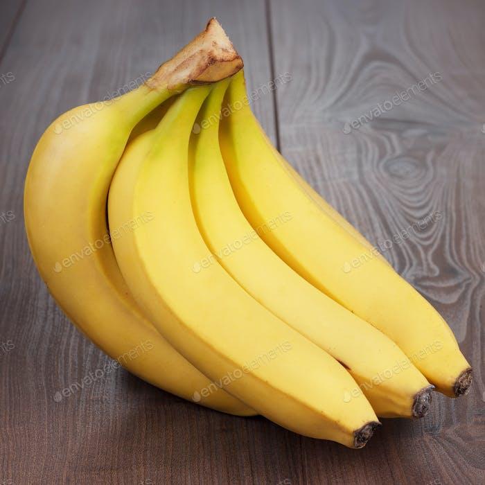Fresh Bananas On The Brown Table