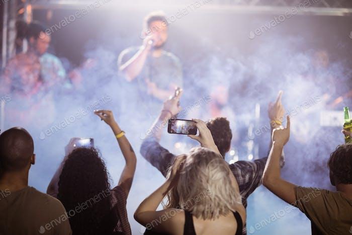 Rear view of fans enjoying music concert