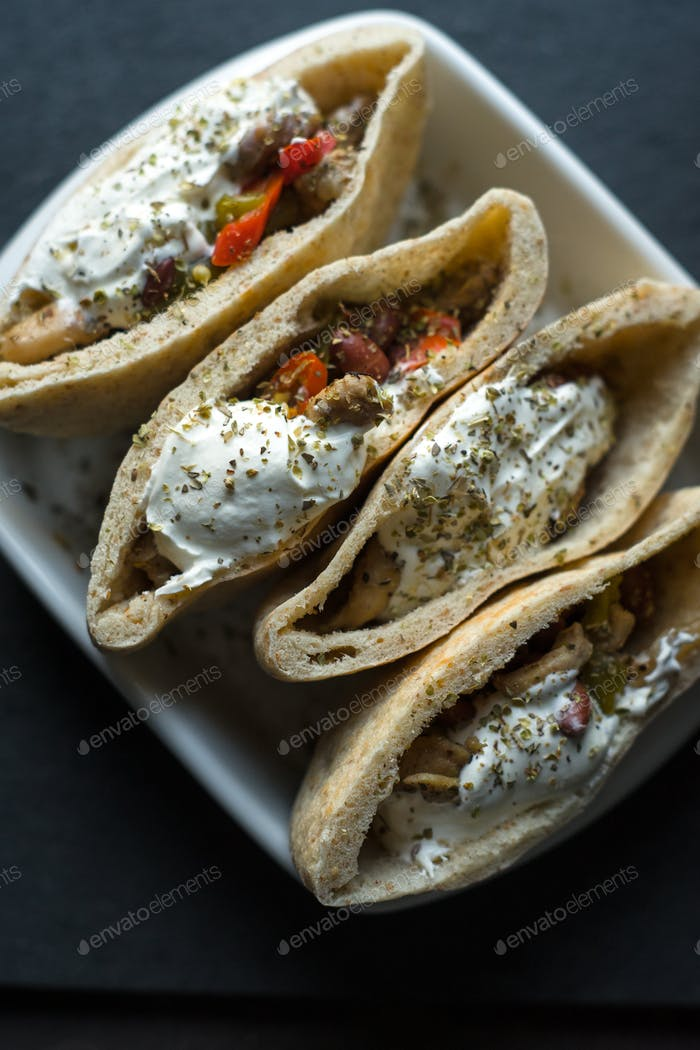 Tortilla stuffed with chicken and vegetables with sour cream. Fajita